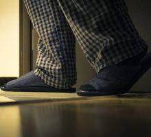 man in plaid pajamas has to get up to pee