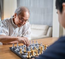 Older man playing chess. Mental activity can help keep your brain healthy