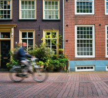 Bicycle rider passes houses