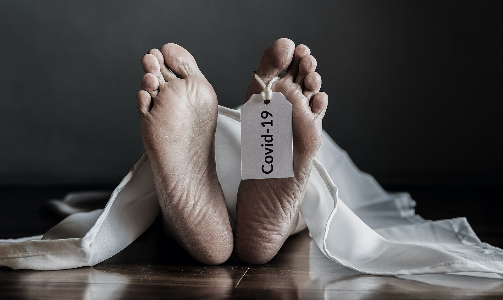 Dead body hanging tag Covid-19. senior people with coronavirus infected death at home, elderly people with congenital disease are at a higher risk of infected covid-19 disease.